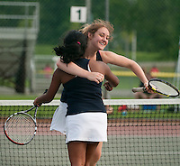 Sunday Swett and Poojita Kasireddy embrace after clinching the NHIAA State Championship girls tennis doubles final at PSU on Friday afternoon.  (Karen Bobotas/for the Concord Monitor)