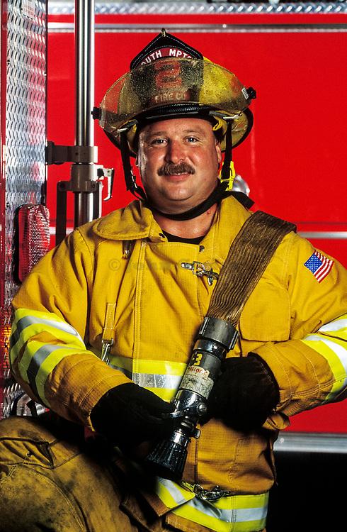 Fireman with fire hose. MR