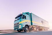 Gulf Agency Company heavy goods vehicle speeding through the desert in the United Arab Emirates.