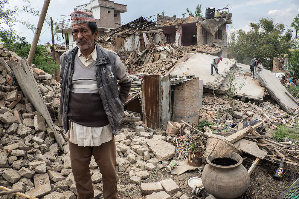 Devastating April 2015 Nepal Earthquake. Kirtipur Municipality, Kathmandu Valley. Villagers working their way into their collapsed homes to save what they can of their belongings and to clear the land of rubble.