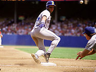 CLEVELAND - 1990:  Ken Griffey Jr. of the Seattle Mariners slides into third base during an MLB game against the Cleveland Indians at Municipal Stadium in Cleveland, Ohio during the 1990 season. (Photo by Ron Vesely)  Subject:  Ken Griffey Jr.