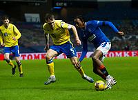Football - 2020 / 2021 Scottish Premier League - Glasgow Rangers vs St Johnstone - Ibrox stadium<br /> <br /> Joe Aribo of Rangers vies with Jason Kerr of St Johnstone<br /> <br /> COLORSPORT/BRUCE WHITE