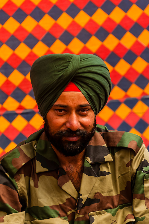 A Sikh Indian Army soldier at the Gurdwara Pathar Sahib, the Gurdwara was built in 1517 to commemorate the visit to the Ladakh region of Guru Nanak Dev, the founder Guru of the Sikh faith. Ladakh, Jammu and Kashmir State, India.