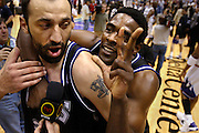 Chris Webber and Vlade Divac celebrate after the game, in game four of the Western Conference Playoffs between the Sacramento Kings and the Utah Jazz, Monday, April 29, 2002 at the Delta Center, Salt Lake City, Utah.