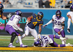 Nov 14, 2020; Morgantown, West Virginia, USA; West Virginia Mountaineers running back Leddie Brown (4) runs the ball during the second quarter against the TCU Horned Frogs at Mountaineer Field at Milan Puskar Stadium. Mandatory Credit: Ben Queen-USA TODAY Sports
