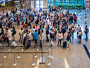 29 DECEMBER 2014 - SINGAPORE, SINGAPORE: People line up to go through immigration at Changi International Airport in Singapore.     PHOTO BY JACK KURTZ