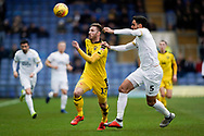 James Henry of Oxford United under pressure from Ryan Tafazolli of Peterborough United during the EFL Sky Bet League 1 match between Oxford United and Peterborough United at the Kassam Stadium, Oxford, England on 16 February 2019.
