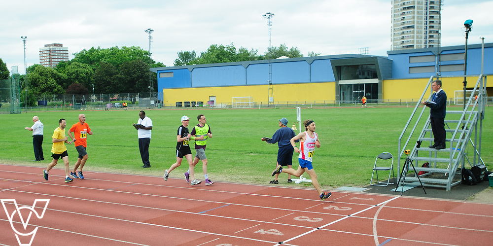 Event: 5000 meter relay<br /> Competitors, from left: David Beynon, Andrew Jones and Competitor #74<br /> <br /> Metro Blind Sport's 42nd Athletics Open, held at Mile End Stadium, Tower Hamlets, London.<br /> <br /> Picture: Chris Vaughan Photography for Metro Blind Sports<br /> Date: June 16, 2018
