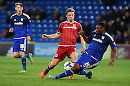 Grant Leadbitter of Middlesbrough is tackled by Kagisho Dikgacoi of Cardiff city. Skybet football league championship match, Cardiff city v Middlesbrough at the Cardiff city Stadium in Cardiff, South Wales  on Tuesday 20th October 2015.<br /> pic by  Andrew Orchard, Andrew Orchard sports photography.