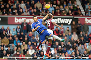 John Terry, the Chelsea captain heads the ball over Diafra Sakho of West Ham United. Barclays Premier League, West Ham Utd v Chelsea at The Boleyn Ground, Upton Park in London on Saturday 24th October 2015.<br /> pic by John Patrick Fletcher, Andrew Orchard sports photography.