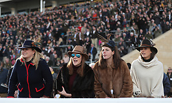 Female racegoers watch the action in the St. James's Place Foxhunter Challenge Cup Open Hunters' Chase during Gold Cup Day of the 2018 Cheltenham Festival at Cheltenham Racecourse.
