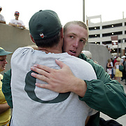 Oregon Ducks football team in Oklahoma for game against against the Sooners..Duck qb Clemens gets a sympathy hug from a relative after the loss to OU.Photos © Todd Bigelow/Aurora