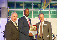 Garden City, New York, U.S.  November 14, 2019. L-R, ANDREW PARTON, President of Cradle of Aviation; HUNTLEY LAWRENCE, Director, Aviation Department, Port Authority, New York, New Jersey; and ARTHUR MOLINS, of TransAero and a CAM Trustee, pose for photo during 17th Annual Cradle of Aviation Museum Air and Space Gala. Youngwall was holding plaque he received for being Aviation Leadership Award honoree