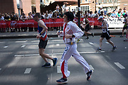 Participant dressed as Elvis taking part in the London Marathon on 22nd April 2018 in London, England, United Kingdom. The London Marathon, presently known through sponsorship as the Virgin Money London Marathon, is a long-distance running event. The event was first run in 1981 and has been held in the spring of every year since. The race is mainly known for ebing a public race where ordinary people can challenge themsleves while raising great amounts of money for various charities.