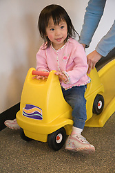 United States, Washington, Bellevue, girl on indoor roller coaster in class at Kindering Center