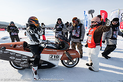 Team mechanic-tuner Simon Pitelet about to take a pass on the mile long course on custom bike builder Bertrand Dubet's partially streamlined Aprilia RSV4 racer during the Baikal Mile Ice Speed Festival. Maksimiha, Siberia, Russia. Saturday, February 29, 2020. Photography ©2020 Michael Lichter.