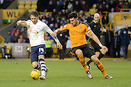 Preston North End striker Joe Garner holds the ball from Wolverhampton Wanderers defender Danny Batth during the Sky Bet Championship match between Wolverhampton Wanderers and Preston North End at Molineux, Wolverhampton, England on 13 February 2016. Photo by Alan Franklin.