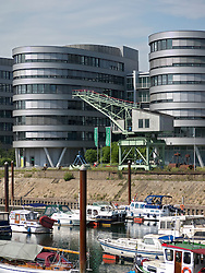 Modern office buildings called the Five Boats and baots in marina at Innenhafen area of Duisburg in North Rhine-Westphalia Germany