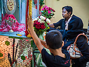 20 OCTOBER 2015 - YANGON, MYANMAR:  People pray at a shrine for Hussein ibn Ali at Punja Mosque in Yangon. Ashura commemorates the death of Hussein ibn Ali, the grandson of the Prophet Muhammed, in the 7th century. Hussein ibn Ali is considered by Shia Muslims to be the third imam and the rightful successor of Muhammed. He was killed at the Battle of Karbala in 610 CE on the 10th day of Muharram, the first month of the Islamic calendar. According to Myanmar government statistics, only about 4% of the population is Muslim. Many Muslims have fled Myanmar in recent years because of violence directed against Burmese Muslims by Buddhist nationalists.   PHOTO BY JACK KURTZ