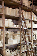 Shelves of clay moulds at Fabrica Ceramica Fundada, an old ceramics factory still working today, in Lisbon, Portugal