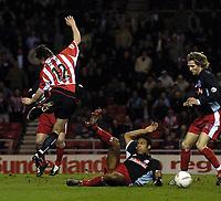 Photo. Jed Wee.<br /> Sunderland v Stoke City, Nationwide League Division One, Stadium of Light, Sunderland. 16/03/2004.<br /> Stoke's Wayne Thomas (C) sends Sunderland's John Oster (L) hurtling through the air as John Halls looks on.