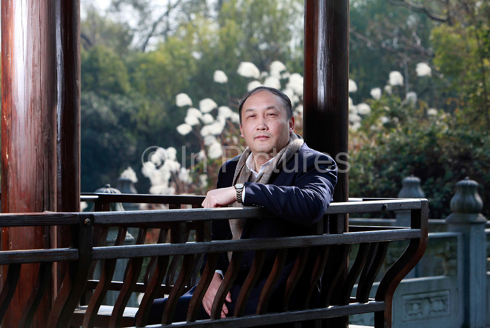 Yang Wei, President of the prestigeous Zhejiang University, poses for photoraphs on campus in Hangzhou, Zhejiang Province, China, on December 13, 2011. Yang has started a campaign to crack down on academic fraude and plagerism that has plagued and discredited China's higher education system.
