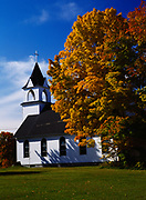 Autumn color of sugar maple and historic Sts. Peter and Paul Catholic Church and now Algomah Acres Honey, Greenland, Upper Peninsula of Michigan.