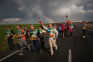 """People run on the 20th Korrika. Lodosa. (Basque Country). March 31, 2017. The """"Korrika"""" is a relay course, with a wooden baton that passes from hand to hand without interruption, organised every two years in a bid to promote the basque language. The Korrika runs over 11 days and 10 nights, crossing many Basque villages and cities. This year was the 20th edition and run more than 2500 Kilometres. Some people consider it an honour to carry the baton with the symbol of the Basques, """"buying"""" kilometres to support Basque language teaching. (Gari Garaialde / Bostok Photo)"""