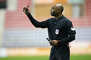 Referee Sam Allison tells the players to wait for the whistle during the EFL Sky Bet League 1 match between Wigan Athletic and Charlton Athletic at the DW Stadium, Wigan, England on 2 March 2021.