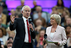 John McEnroe and Sue Barker on No.1 court at The All England Lawn Tennis Club, London.