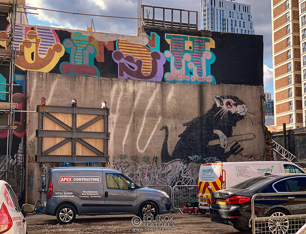 London, United Kingdom - 15 August 2019<br /> EXCLUSIVE SET - Aerial construction specialists and demolition experts use a huge crane to carefully lift intact, a twenty five ton, two-story wall, to preserve a famous Banksy rat image which has been covered up for years. Teams from specialist companies have spent over six weeks cutting around the artwork and fitting custom made eight ton steel supports to enable them to save the historic piece of art. Work has started on the construction of a new twenty seven floor art'otel hotel on the site of the old Foundry building in Shoreditch, east London, and a condition of the planning permission was to preserve the historical Banksy graffiti. A second section of the painting, an image of a TV being thrown through a broken window has already been cut out and moved separately. After the hotel construction is complete the two parts of the Banksy painting will be displayed on the hotel. Our pictures show the stages of work to protect the image, culminating in the lifting of the three story wall by crane. Video footage also available.<br /> (photo by: EQUINOXFEATURES.COM)<br /> Picture Data:<br /> Photographer: Equinox Features<br /> Copyright: ©2019 Equinox Licensing Ltd. +443700 780000<br /> Contact: Equinox Features<br /> Date Taken: 20190815<br /> Time Taken: 154314<br /> www.newspics.com