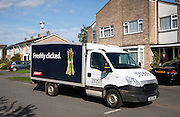 Tesco delivery van vehicle parked outside a house, Woodbridge, Suffolk, England
