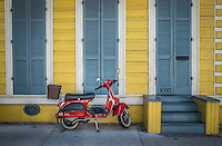 NEW ORLEANS - CIRCA FEBRUARY 2014: View of a typical facade in the New Orleans French Quarter in Louisiana, with motorcycle in the front.
