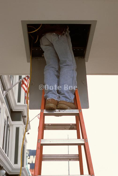 repairman on ladder