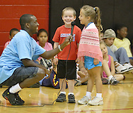 Middletown, N.Y. - A counselor holds the microphone while two children from the YMCA summer sing together during a talent show in the YMCA gymnasium on Aug. 25, 2006.