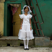 Namrata (11) in a white dress on the occasion of India's independence day. Dharavi, August 2007