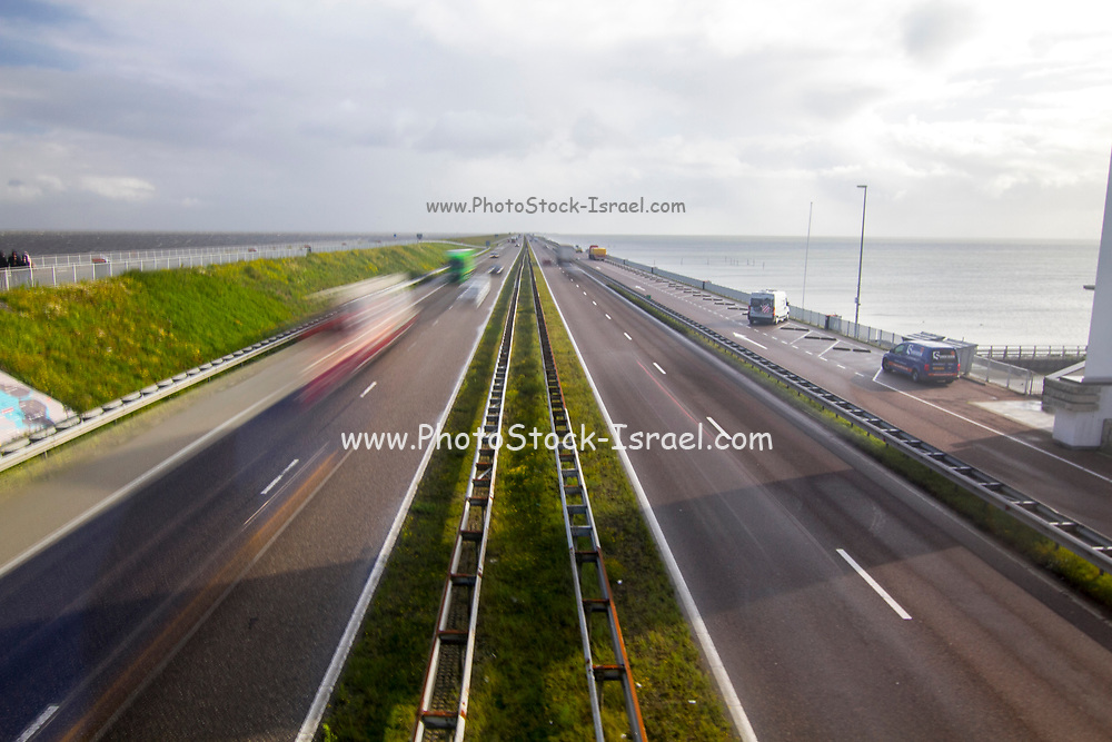 Motorway A7 on Afsluitdijk, a dam separating the North Sea from the Ijsselmeer lake. View from bridge at Breezanddijk, an artificial island created by building the  dam across the entrance to the ZuiderZee