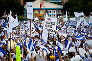 Protestors supporting President Micheletti rally outside the Presidents house in Tegucigalpa on July 3, 2009. Ousted president Zelaya is supposed to return this weekend, however Micheletti has promised to put him in jail if he enters the country.