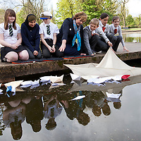.IN PURSUIT OF THE QUESTION MARK.THE WORK OF GEORGE WYLLIE INSPIRES A NEW GENERATION ..Picture shows : Fiona Hylsop, Cabinet Secretary for Culture and External Affairs with local school children from the nearby Riverside Primary School and St Saviours  ( School kids  l-r  - Elise Caldwell, Zoya Salah, John Cotlet of Riverside  and Reegan MacLeod, Josephine Barns and Charley Brown of St Saviours ) who are involved in the Friends of George Wyllie project release paper boats into a pond in Elder Park, Govan, Glasgow, mirroring plans for the wider project, as part of the year-long Whysman Festival. (www.whysman.co.uk)..Picture Drew Farrell.Tel : 07721-735041..The BIG Little Paper Boat Project..Schools in the towns on all sides of the Clyde, will be invited to participate in this project, with the potential involvement of thousands of pupils at all stages and sectors of education across over 575 schools...Using new education resources inspired by Wyllie's art, and which focus on the outcomes and experiences of Curriculum for Excellence, pupils from Clydeside schools across all levels will have the opportunity to explore industrial change in their area and learn about skills once used there. ..Echoing the creation of Wyllies famous Paper Boat, the young people will create a flotilla of Origami Line paper boats. Activities inside The Big Little Paper Boat Shed will form a major part of a George Wyllie retrospective at The Mitchell, Glasgow from 3rd November 2012 - January 31 2013...He gave the world social sculptures to remember. The Straw Locomotive and The Paper Boat, to name but two. Now Glasgow-born artist George Wyllies creative legacy is set to inspire a new generation, thanks to a major award from the Year of Creative Scotland, 2012...Former Customs & Excise officer George Wyllie, now aged 90 and living in a care home for retired mariners in Greenock, always wanted to engage the wider world in his creative vision. ..Part of The Year of Creative Scotland 2012, In