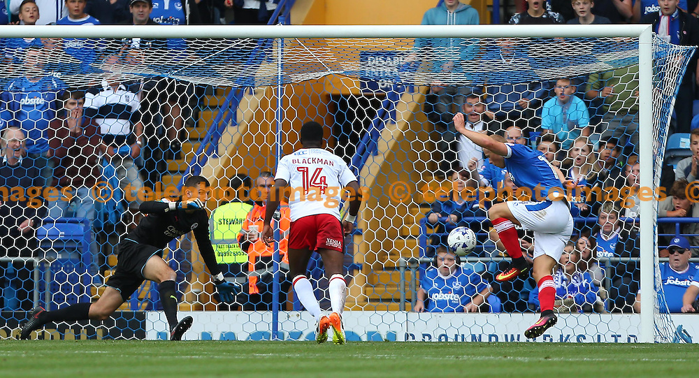 Curtis Main of Portsmouth scores past Crawley's Goalkeeper Yusuf Mersin during the Sky Bet League 2 match between Portsmouth and Crawley Town at Fratton Park in Portsmouth. September 3, 2016.<br /> James Boardman / Telephoto Images<br /> +44 7967 642437