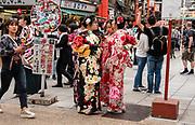 Japanese women in kimonos in Asakusa district, Tokyo, Japan.