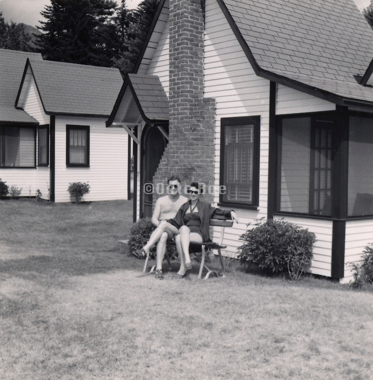 A couple sitting in front of there vacationing house