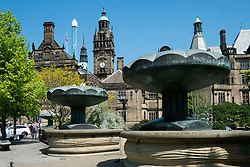 "The fountains entrance to Sheffield  Peace gardens with the old town hall as a backdrop Sheffield City Centre. The 64 metre high clock-tower is surmounted by a statue of Vulcan to the left is the tower of the ""Starflyer"" the Uk's tallest city center attraction at 70 meters.<br />  05 June 2016<br />  Copyright Paul David Drabble<br />  www.pauldaviddrabble.photoshelter.com"