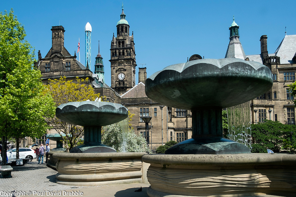 """The fountains entrance to Sheffield  Peace gardens with the old town hall as a backdrop Sheffield City Centre. The 64 metre high clock-tower is surmounted by a statue of Vulcan to the left is the tower of the """"Starflyer"""" the Uk's tallest city center attraction at 70 meters.<br />  05 June 2016<br />  Copyright Paul David Drabble<br />  www.pauldaviddrabble.photoshelter.com"""