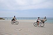 Israel, Tel Aviv, bicycle riders on the beachfront promenade