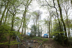 Wendover, UK. 4th May, 2021. A section of ancient woodland at Jones Hill Wood in the Chilterns AONB to the right of the fencing is currently being cleared for the HS2 high-speed rail link by contractors working on behalf of HS2 Ltd. Felling of the woodland, which contains resting places and/or breeding sites for pipistrelle, barbastelle, noctule, brown long-eared and natterer's bats and is said to have inspired Roald Dahl's Fantastic Mr Fox, recommenced after a High Court judge refused an application for judicial review and lifted an injunction.