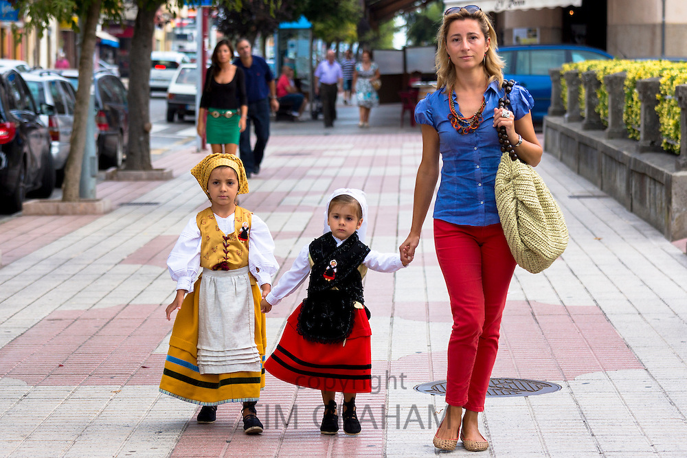 Contrast of modern and traditional outfits at fiesta at Villaviciosa in Asturias, Northern Spain