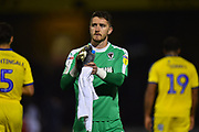 Joe McDonnell (24) of AFC Wimbledon applauds the travelling fans at full time after Wimbledon lost 2-0 to Bristol Rovers during the EFL Sky Bet League 1 match between Bristol Rovers and AFC Wimbledon at the Memorial Stadium, Bristol, England on 23 October 2018.
