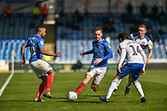 Portsmouth Midfielder, Tom Naylor (7) gets past Rochdale Midfielder, Oliver Rathbone (14) during the EFL Sky Bet League 1 match between Portsmouth and Rochdale at Fratton Park, Portsmouth, England on 13 April 2019.