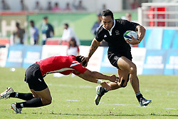 Hosea Gear fends off the tackle to score a try during the XIX Commonwealth Games 7s rugby match between New Zealand and Canada held at The Delhi University in New Delhi, India on the 11 October 2010..Photo by:  Ron Gaunt/photosport.co.nz